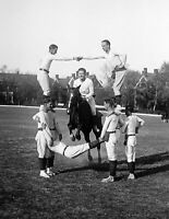 """1930 Horse Jumping Through a Group of Men Vintage Old Photo 8.5"""" x 11"""" Reprint"""