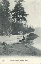 Seattle~Man Rests Foot on Little Log, Looks @ Huge One ~Driftwood Islands~1910