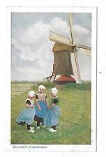 Zeeland Walcheren - Three Dutch Children Girls standing in front of a windmill