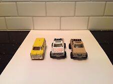 (2) 1977 Hot Wheels GMC 1:64 Scale Pickups and Yellow Van