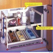 Under sink storage shelf creates organization space, custom fits