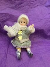 Vintage Porcelain Doll In Winter Garb. 5 Inches Tall Jointed Arms/Legs