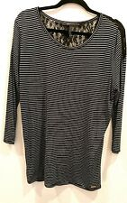 BCBG size large long sleeved top Black and white stripped with lace yolk in back