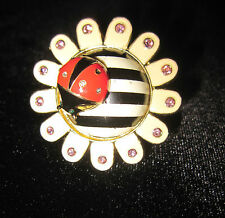 BETSEY JOHNSON BLACK AND WHITE STRIPPED FLOWER WITH A LADYBUG RING SIZE 7