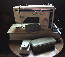 Necchi Mod.884 FB sewing machine with attachments and original box.Vintage.