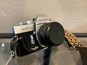 Minolta SRT101 Camera w 4 Lenses, Flash, Handles, and Case