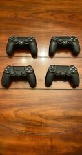 Lot of four official Sony PlayStation 4 (PS4) controllers