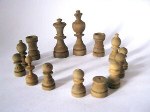 ANTIQUE OLD RARE UNUSUAL CHESS PIECES , WOODEN   .