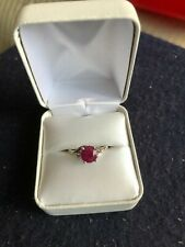 3-stone ring with natural Burma ruby in 10kt white gold setting ring