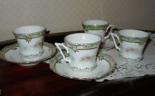 Porcelain 4 cups and saucers maybe Limoges one broken saucer & prof. fixed demit
