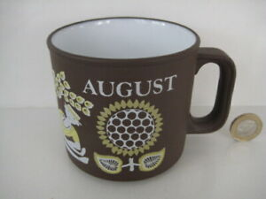 1970's HORNSEA POTTERY AUGUST MONTH SUNFLOWER CORN LOVE MUG BY KENNETH TOWNSEND.