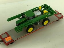 Showcase Line 50' flat with a JOHN DEERE Weed Sprayer  Chained IN BOX Custom
