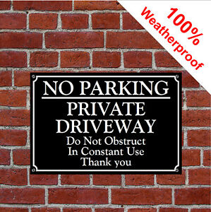 No parking private driveway do not obstruct in constant use thank you sign 3055