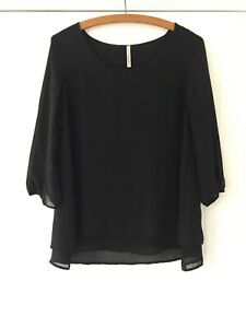 My Story Floaty Black Top. Size 10. 3/4 length Sheer Sleeves. Good Condition.