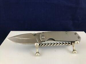 Schrade SCH303M pocket knife carbon steel gray plain edge blade frame liner