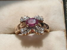 Q79 Ladies 14ct oval cut 1/2 carat Ruby and Diamond ring size L
