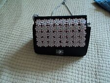 Catherine Malandrino Black Handbag with shoulder chain and pink flowers.