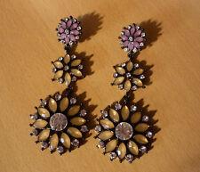 Lange grote oorbellen met 3 paars champagnekleurige bloemen NIEUW