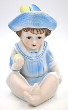 Piano Baby Boy in Blue Feather Cap Holding Apple Bisque Porcelain Figurine
