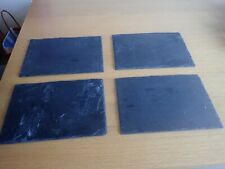 Set of four Slate Table Place mats settings with pads fitted