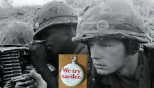1967 Avis WE TRY HARDER Button worn on US GI Camo M1 Helmet Covers In Vietnam