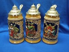 3 Small German-Made Decorated Ceramic Beer Steins with DBGM Lids