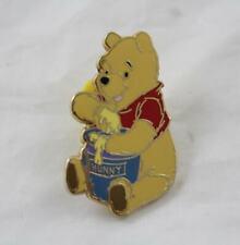 Pin's Winnie l'ourson DISNEYLAND PARIS pot de miel 3 cm (DOU20)