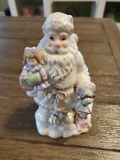 Lenox Santa Claus porcelain figurine holding a doll and a lantern