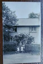 CHILDREN  IN FRONT OF A HOUSE POSTCARD