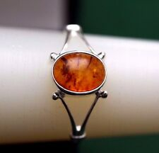 A  delicate pretty  sterling silver ring with Baltic amber stone,in size O