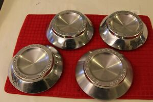 4 VINTAGE PONTIAC 1963-64 CENTER CAPS FOR 8 LUG WHEELS & Alum Drums Good Cond