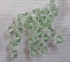 20 genuine Swarovski Crystal 4mm bicone beads chrysolite shade