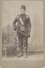 CABINET CARD PORTRAIT OF FOREIGN MILITARY OFFICER W/ SWORD, MEDALS, AND MORE