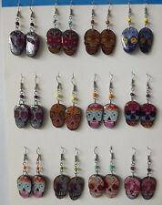 Lot of 20 pairs of Peruvian Skull earrings . Acrylic.