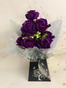 Artificial purple rose bush in a black gift box silver tree design tissue paper