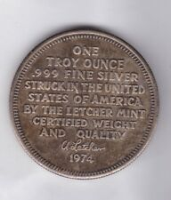 1974 USA LETCHER MINT SILVER ONE OUNCE ROUND IN EXTREMELY FINE CONDITION.