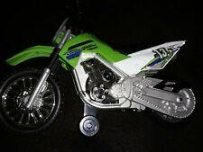 TOY STATE  KAWASAKI KLX 140 WHEELIE BIKE MOTORIZED W/ LIGHT UP  GLOW SOUND MUSIC