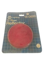 NEW IN PACKAGE NAPA LIGHTING STICK-ON ADHESIVE TURBO RED REFLECTOR 18-0600, F19