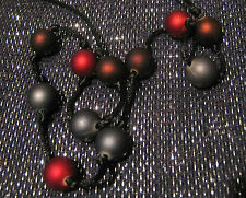 Lovely bootlace style necklace with gorgeous spaced beads in matt colours