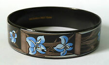 A WIDE VINTAGE 1980s MICHAELA FREY TEAM ENAMEL FLOWER BANGLE