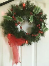 "Christmas wreath with holy decoration that lights up 14"" diameter"