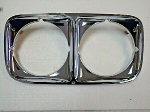 NOS 1973 Pontiac Catalina Safari Wagon Grandville Headlight Bezel # 488216