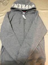 Supreme size XL hoodie with white supreme logo on hood