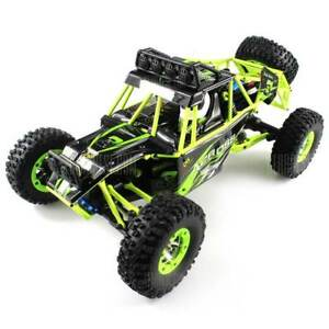 WLtoys No 12428 1 / 12 2.4GHz 4WD RC Off-road Car  BLACK AND GREEN 35 - 50km