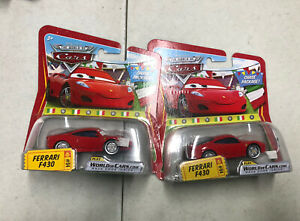 2 Disney Pixar Cars Ferrari F430 #94 CHASE package with World of Cars Code