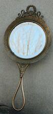 ancien miroir face a main en bronze finement décoré