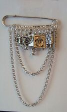 KILT PIN BROOCH  ON A HEBREW THEME  9 CHARMS  7CM WIDE X 11 CM LONG SILVER PLATE