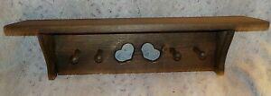 "Handcrafted wood wall shelf, 5 1/2"" x 24"", heart cutouts, four pegs, 6 1/2"" high"