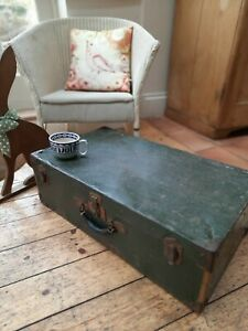 Fabulous large green tin trunk/demob suitcase with brass trim and leather handle