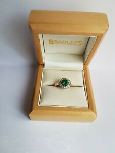 9ct Yellow Gold Emerald Halo ring. UK size L 1/2